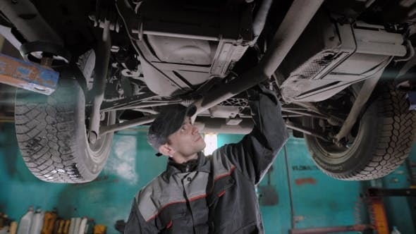 Thumbnail for Adult Man Checks the Condition of the Vehicle in a Tire Service Shop