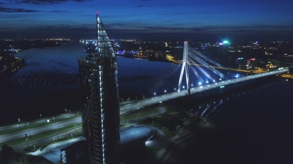 Thumbnail for Riga City Night Time Bridge Autumn Drone Flight