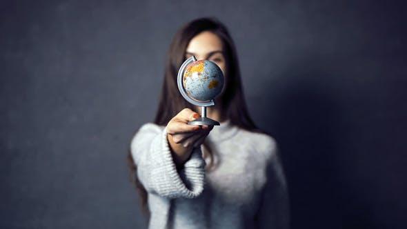 Thumbnail for Girl Turns the Globe