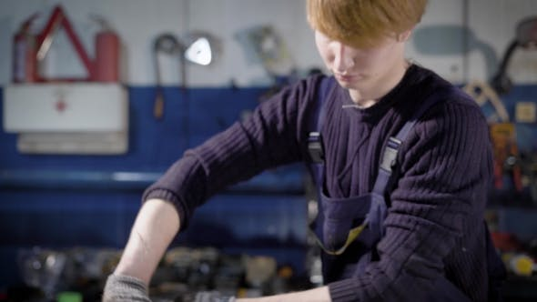 Thumbnail for Shot of a Young Mechanic Working with a Car Engine in the Garage.