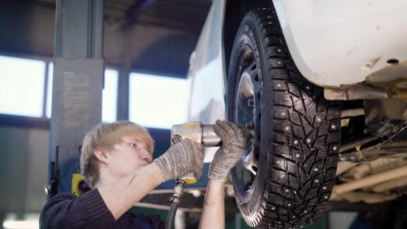 Thumbnail for Mechanic Is Working with a Tires in the Garage.
