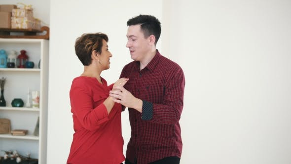 Thumbnail for Family Couple - Male and Female Is Dancing Kizomba in White Studio Near Window