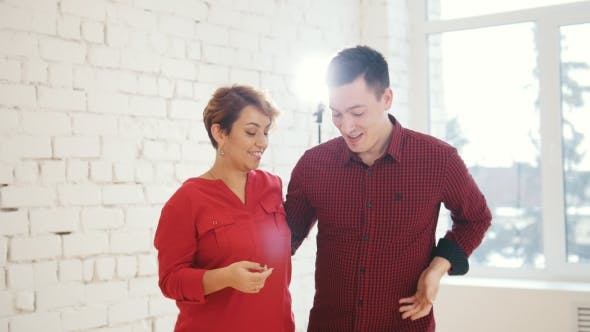 Thumbnail for Middle Age Woman and Young Man Is Dancing Kizomba in Studio,