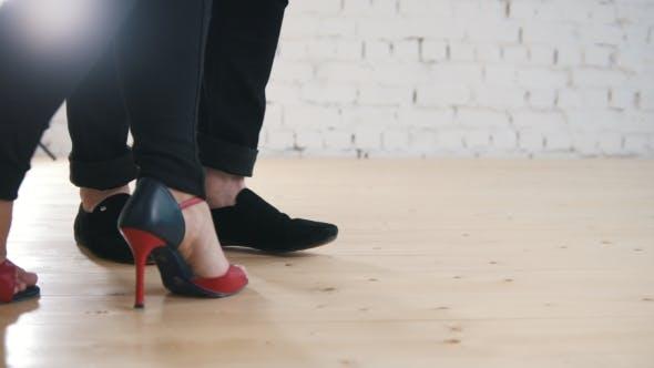 Thumbnail for Dancers Feet - Family Couple Is Dancing Kizomba in Studio