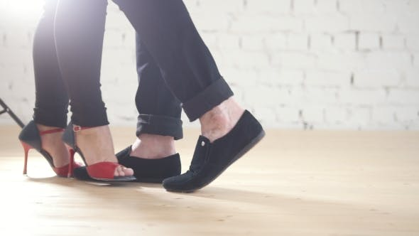 Cover Image for Dancers Feet Wearing Fashion Shoes - Family Couple Is Dancing Kizomba in Studio