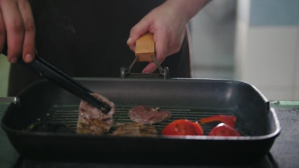 Thumbnail for Chef on Kitchen Is Frying Meat and Vegetables in a Pan