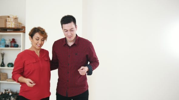 Thumbnail for Two Professional Dancers in Red Shirts - Female and Male Is Dancing Together in Studio