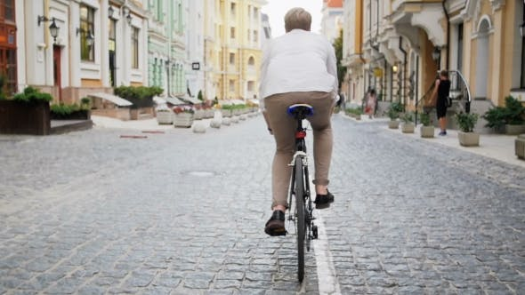 Thumbnail for Young Man Commuting To Work on Vintage Sport Bicycle
