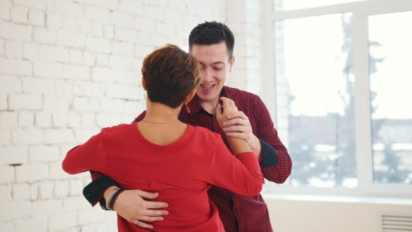 Thumbnail for Middle Age Female and Young Man Is Dancing Kizomba in Studio,