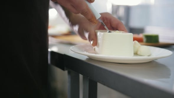 Thumbnail for Chef Cut the Cheese Feta for Salad in Commercial Kitchen