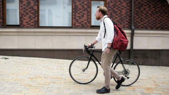 Thumbnail for Young Hipster Man Walking with Black Vintage Bicycle