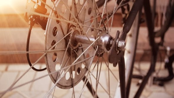 Thumbnail for Vinatge Bicycle Wheel Slowly Rotating in Sunset Rays