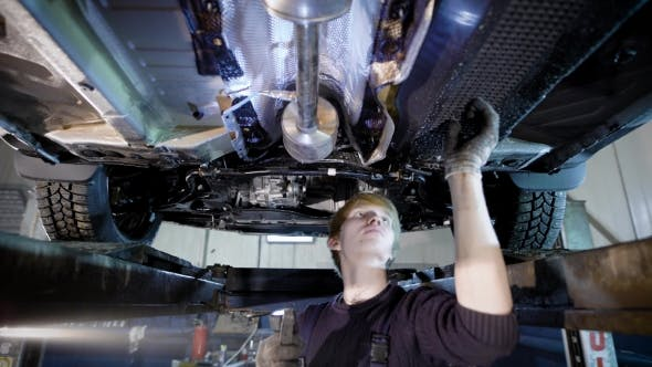 Thumbnail for a Professional Mechanic Checks the Condition of Vehicles in a Tire Repair Shop