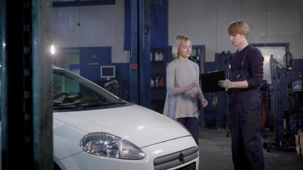 Thumbnail for Professional Mechanic Gives the Customer a Car That Was Repaired in a Car Workshop