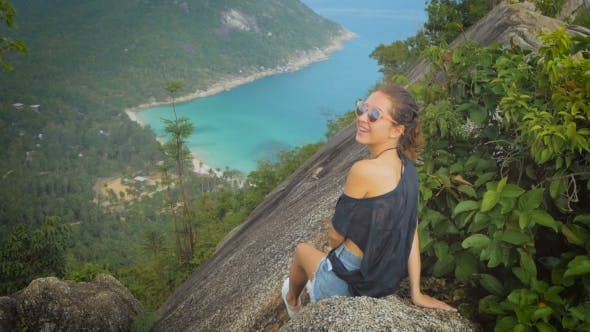 Thumbnail for Girl Enjoy Picturesque View of the Island at a Height, Smiling on Camera