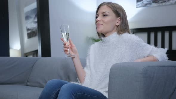 Thumbnail for Relaxing Woman Drinking Champagne Wine, Sitting on Couch