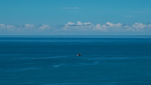 Fishing Boat in Blue Sea, Fishing Vessel Underway To Fishing Harbour