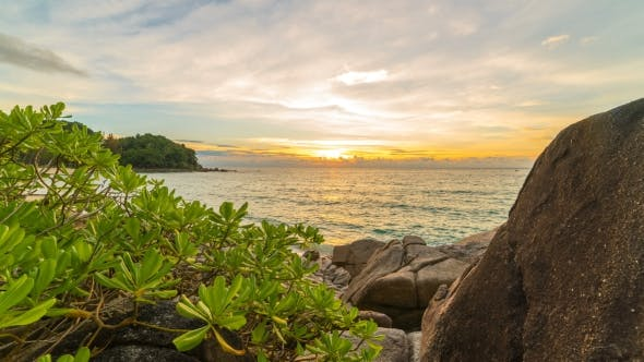 Thumbnail for Rocks with Tropical Plants on the Beach at Sunset  in Phuket, Thailand