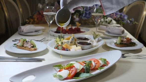 Thumbnail for Healthy Food and Vegetarian Concept.  of Pouring Olive Oil Over Caprese Salad. Italian Caprese Sala