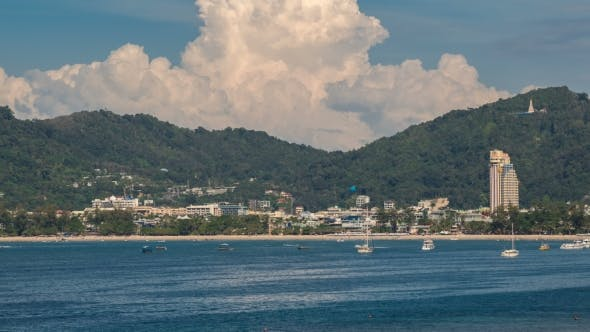Thumbnail for View of Patong Beach over City, Mountains and Sky Backround in Phuket, Thailand