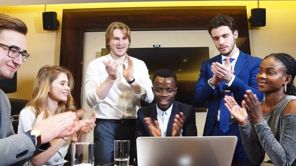 Thumbnail for Portrait of Group Happy Business People Look To Camera and Applaud Their Business Success.
