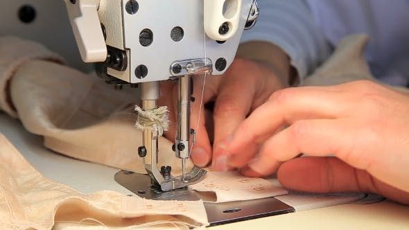 Thumbnail for Seamstress at Work By the Sewing-machine
