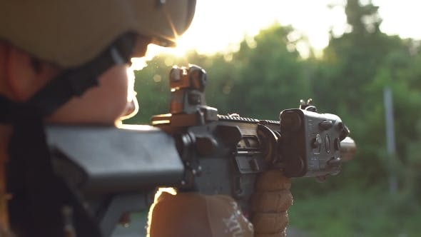 Thumbnail for Soldier in Camouflage with a Gun Looking through the Scope