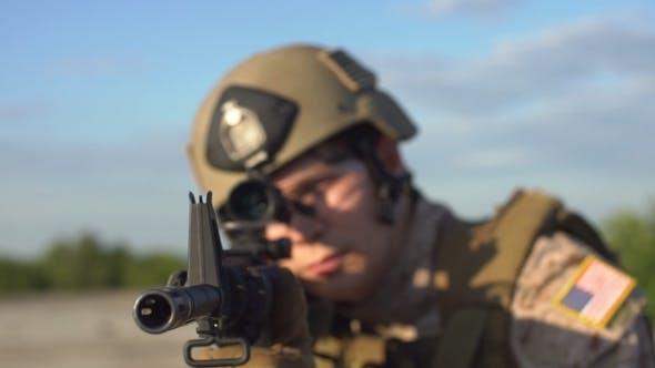 Thumbnail for Armed Man Taking Aim. Airsoft.