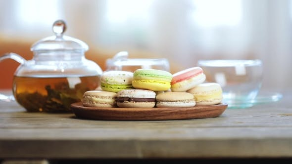 Thumbnail for Colorful Macaron (Macaroon) on the Table with Hot Tea