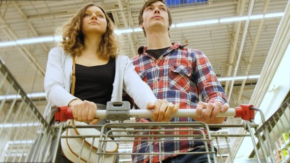 Thumbnail for Tired Young Couple with Cart Choosing the Vegetables at the Store