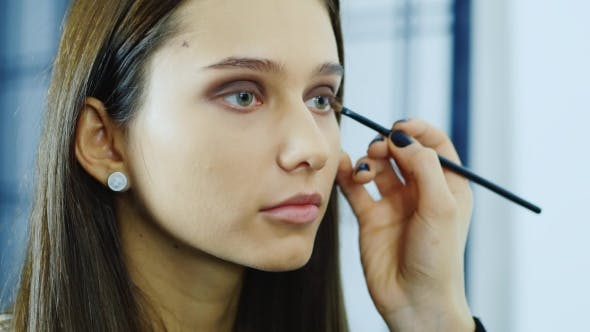 Thumbnail for Young Woman Apply Makeup Around the Eyes