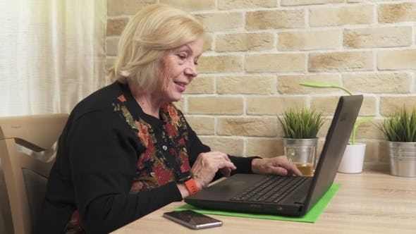 Thumbnail for Happy Old Woman Using a Laptop Computer