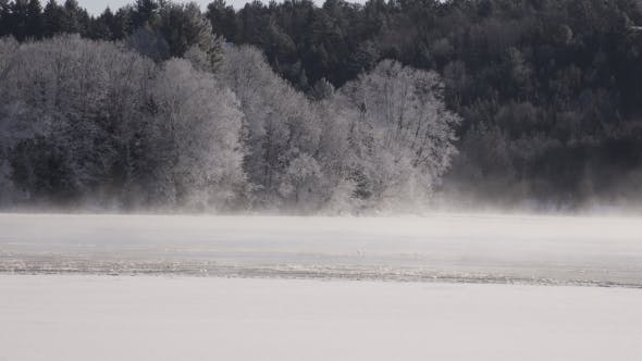 Thumbnail for Fog Moving on a Half Frozen River with Frosty Trees