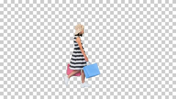 Thumbnail for Little girl walking by with shopping bags, Alpha Channel