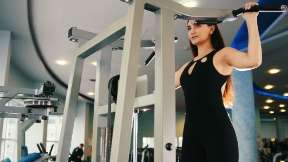 Thumbnail for Black Hair Woman Exercising in Gym - Training for Shoulders