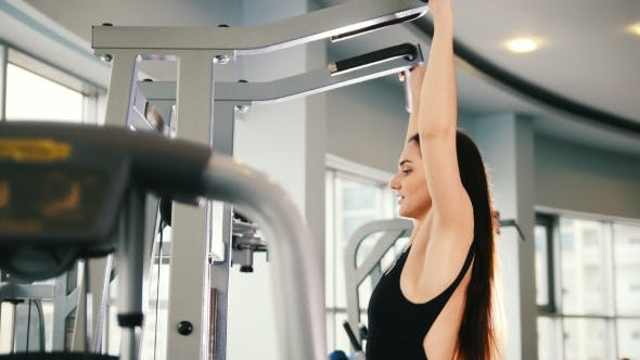 Thumbnail for Attractive Young Woman Exercising in Gym - Training for Shoulders