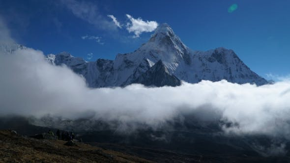 Thumbnail for The Movement of Clouds Over the Mountain Ama Dablam
