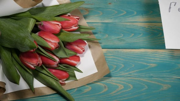 Forgive Me Message and Tulips Flowers Bouquet on a Wooden Table Couple Relationship