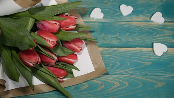 Wedding Day Message and Tulips Flowers Bouquet on a Wooden Table Couple Relationship