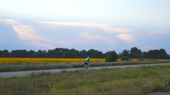 Thumbnail for Unrecognizable Man Riding Bicycle in Country Road