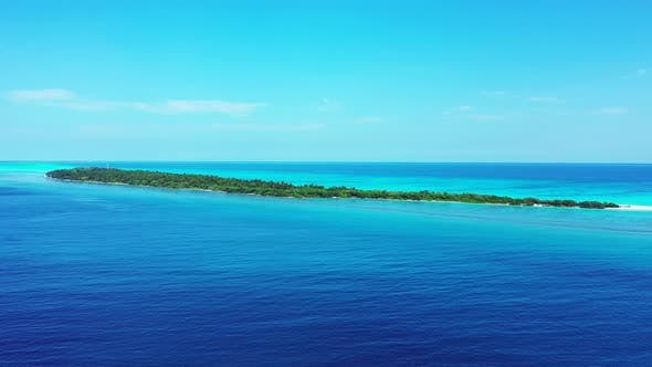 Thumbnail for Wide angle above clean view of a paradise sunny white sand beach and blue sea background in vibrant