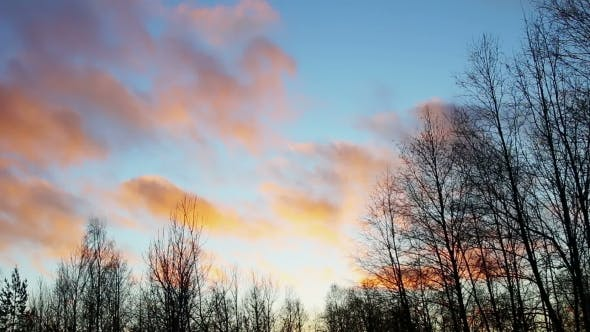 Thumbnail for Clouds Run Through the Sky in Winter Sunset Landscape