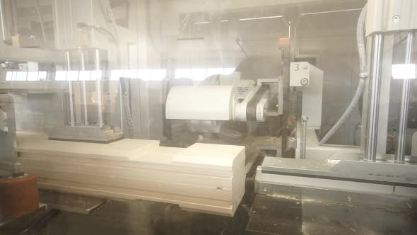 Woodworking Machine Processing Wood and Timber at the Milling Beam
