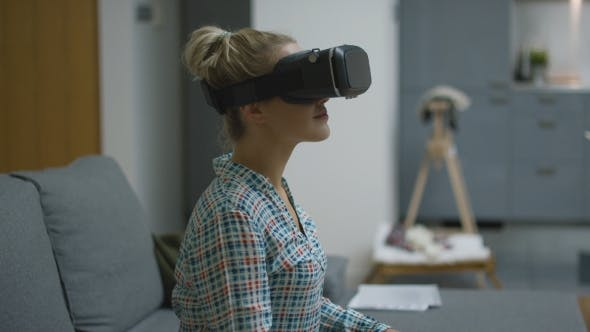 Thumbnail for Young Woman in VR Headset