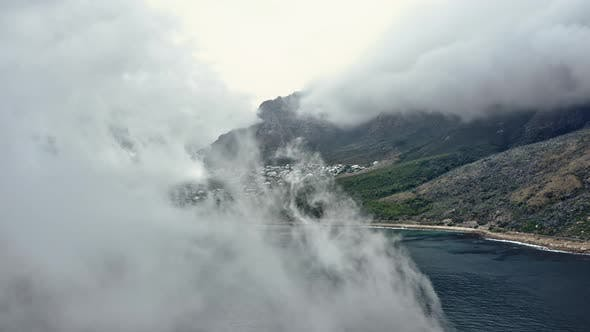 Thumbnail for Drone Shot of the Mountains and Sea Covered By Fog