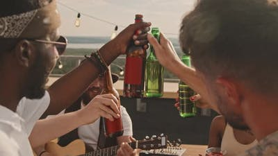 Friends Toasting and Enjoying Music on Rooftop Terrace