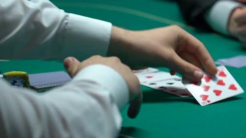 Man Winning Poker, Grasping Tokens and House Keys, Fortunate Evening, Closeup