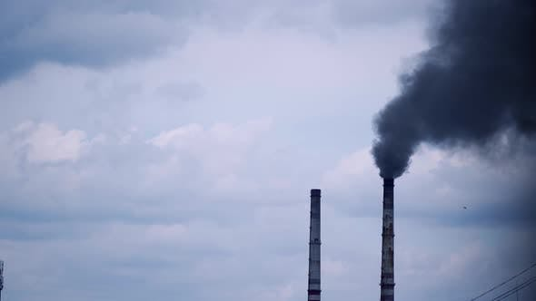 Thumbnail for Smoke from industrial chimney. Factory with main chimneys expelling smoke into sky