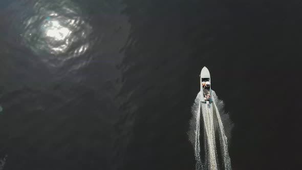 Thumbnail for Men Riding Motor Boat on Dark River