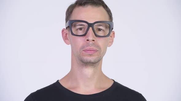 Thumbnail for Studio Shot of Happy Nerd Man Smiling While Wearing Eyeglasses